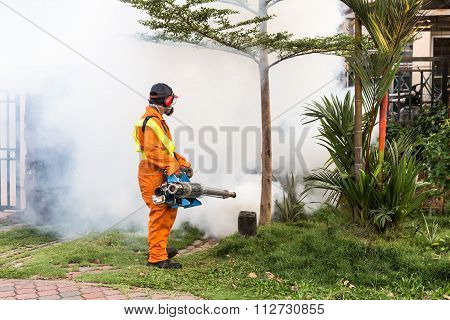 Worker Fogging Residential Area With Insecticides To Kill Aedes Mosquito