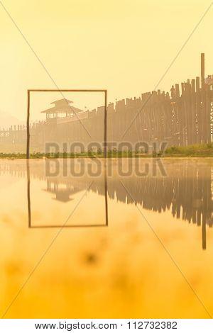 Sunrise in U bein bridge the oldest and longest teak wooden bridge in the world Taungthaman lake Amarapura Myanmar