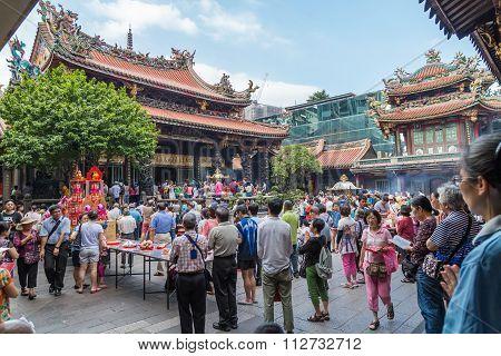 Taipei, Taiwan - Circa September 2015: People Pray In Longshan Buddhist Temple In Taipei City,   Tai