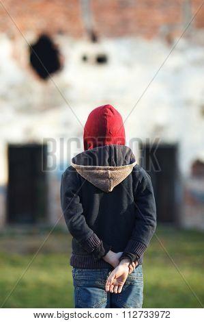 Dramatic Portrait Of A Little Homeless Boy