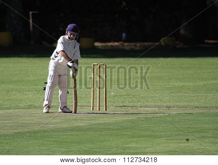 Focused Cricket Boy Preparing To Bat