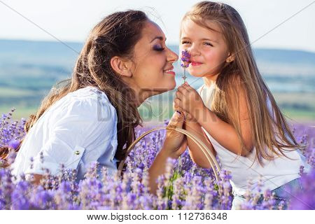 Mother with daughter in lavender