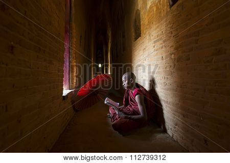 Bagan, Myanmar - Feb 20, 2015 : Unidentified Buddhism Neophyte Prays In Buddihist Temple On Feb 20,