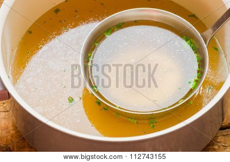 Saucepan With Bouillon With A Ladle