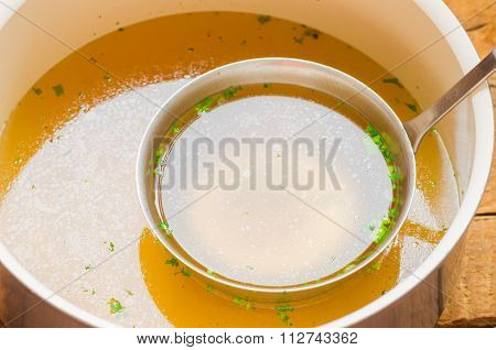 Casserole With Meat Broth With A Ladle
