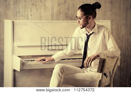 Musical concept. Pianist plays the piano.