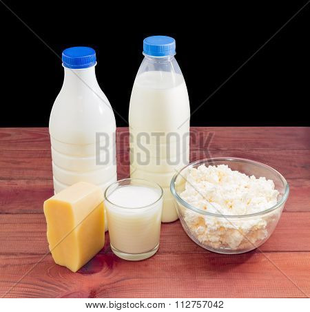 Dairy Produce On A Dark Wooden Surface