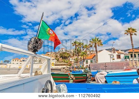 Camara De Lobos - Motorboat With Portuguese Flag At The Harbor