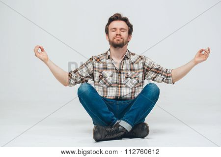 Young Beard Man Sitting On Floor Meditate