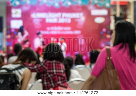 Blurred People In The Hall During Happiness Festival