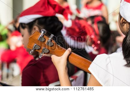 Blurred Childrens Playing Ukulele During Christmas Day