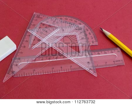 Drafting Instruments On Red.