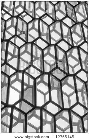 An interior view of a glass facade of the Harpa Concert Hall and Conference Centre