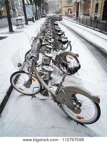 PARIS, FRANCE - CIRCA JANUARY 2010: A Velib' station after a snow fall.