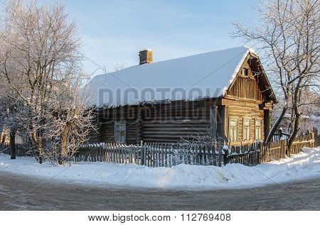 Old Log House In Winter Time