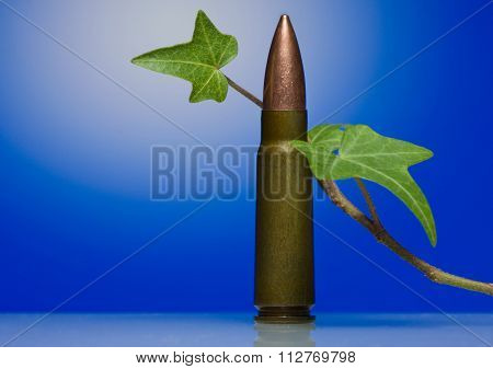 Gun Machine Cartridge And Liana Stalk- Antiwar Concept