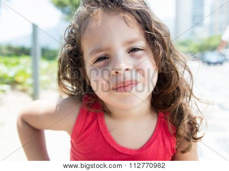 Cool Child In A Red Shirt Outside Looking At Camera