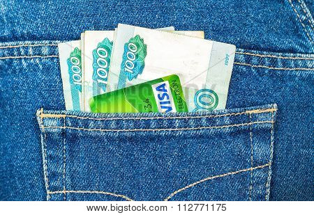 Russian Rouble Banknotes And Credit Card Visa Sticking Out Of The Back Jeans Pocket