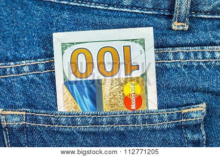 Credit Card Mastercard With Us Dollars Sticking Out Of The Back Jeans Pocket