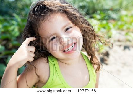 Laughing Child In A Yellow Shirt Outside