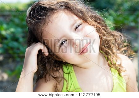 Smiling Child In A Yellow Shirt Outside