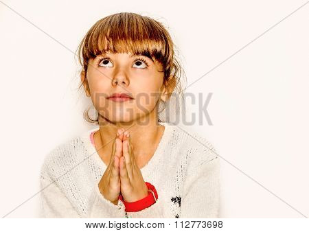 Beautiful Little Girl Praying And Looking Up, Isolated On White
