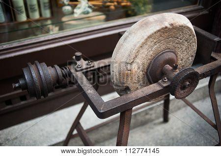 Antique Sharpening Wheel Closeup