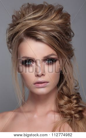 Female With Modern Curly Hairstyle .