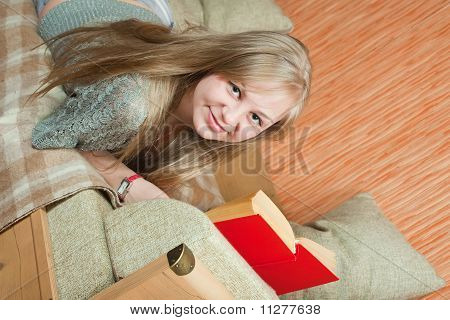 Relaxed Woman Lying On Sofa
