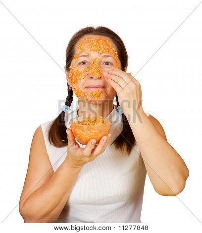 Mature Woman Making Bio Cosmetic Pack