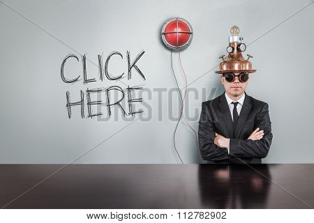 Click here text with alert light and vintage businessman
