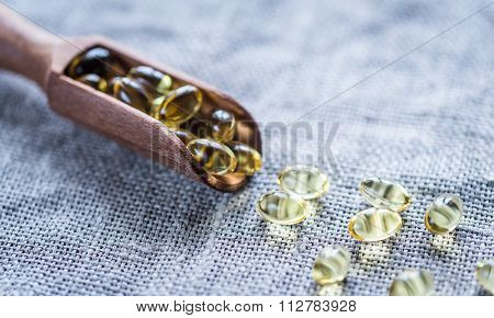 Omega-3 Capsules In The Wooden Scoop