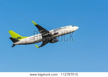 Air Baltic Airlines Boeing 737 leaving Riga International Airport