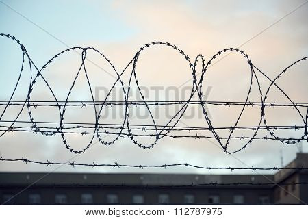Barbed Wire Fence Layed Around Prison Walls