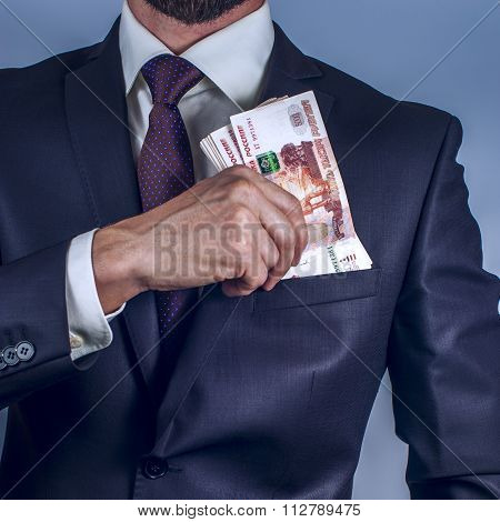 Bearded man removes rubles in his suit pocket