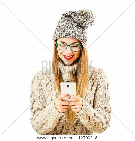 Smiling Winter Hipster Girl in with Mobile Phone on White