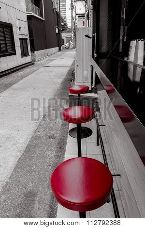 Red stools at an empty lunch counter