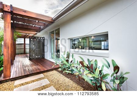 Beautiful Picture Of Lawn With Wooden Floor And Garden