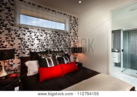A Beautiful Romantic Bedroom With Multi Colours Cushions And Attach Bathroom