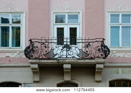 Vintage Open Wrought-iron Balconies On The Background Of Windows And Pink Wall