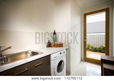 Beautiful Washing Room With A Washing Machine And Sink