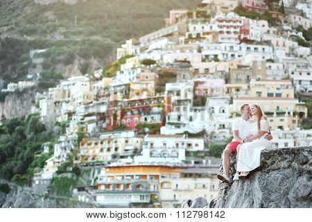 Young Couple Tenderly Together In Honeymoon In Positano, Amalfi Coast, Italy