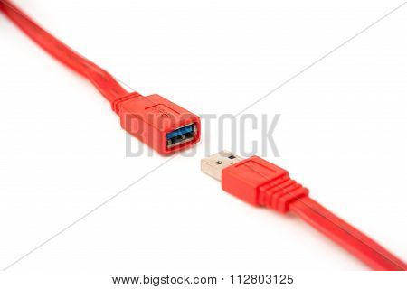 Male And Female Heads Of Red Usb Cable On A White Background