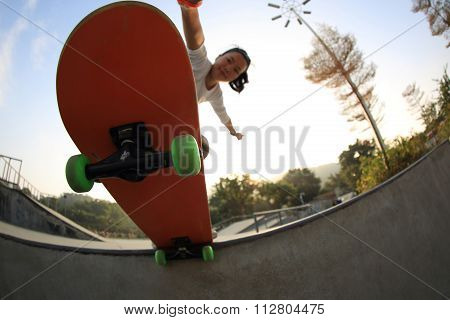 closuep of skateboarder skateboarding at skatepark