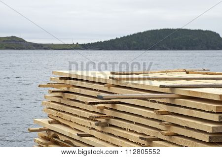 Stack Of Lumber By The Ocean