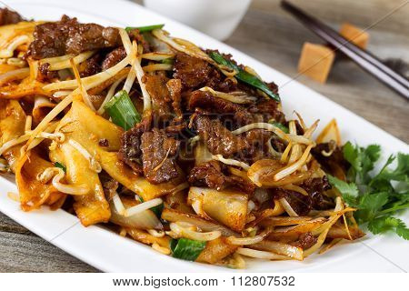 Chinese Spicy Beef And Vegetable Dish In Plate Setting Ready To Eat