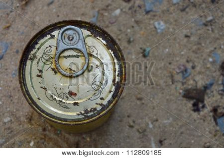 rusty tin can food on the ground