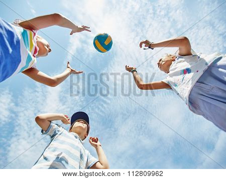 View from below of kids playing ball