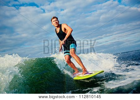 Young surfer catching a big wave