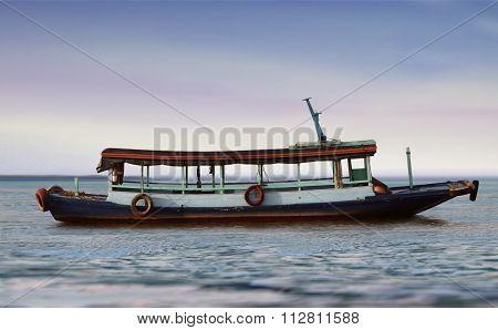 Small Empty Passenger Boat At Sea